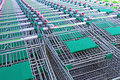 Rows Of A Plurality Of Shopping Trolleys In A Supermarket Stock Photo - 44499490