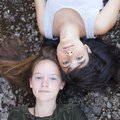 Two Teen Girl Best Friends Lying On The Rocks, Top View. Outdoors. Stock Photos - 44508393