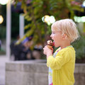 Lovely Preschooler Girl Eating Ice Cream Outdoors Royalty Free Stock Image - 44513926