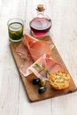 Italian Prosciutto Ham With Olives And Bread Royalty Free Stock Photos - 44531778