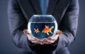 Businessman Holding Small And Big Gold Fish Stock Image - 44539061