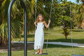 Joyful Smiling Little Girl On A Swing In Tropical Garden Royalty Free Stock Images - 44539459