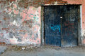 Old Painted Wall  With Black Iron Gates Closed Royalty Free Stock Photos - 44555428