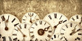 Various Vintage Clock Faces In Front Of An Old Wall Stock Photography - 44562702