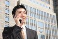 Japanese Businessman Talks With A Mobile Phone Stock Photo - 44563960