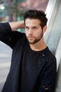 Trendy Young Man Posing With Hand In Hair Stock Photos - 44594273