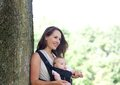 Mother Smiling With Infant In Baby Carrier Stock Images - 44597054