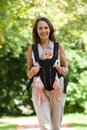 Happy Mother Walking With Infant In Baby Carrier Royalty Free Stock Image - 44597286