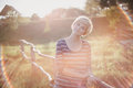 Young Woman At The Sunset Near Fence On The Country Background Royalty Free Stock Photos - 44603968