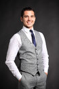 Handsome Young Business Man Standing On Black Royalty Free Stock Photos - 44611078