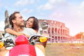 Italy Rome Couple On Scooter By Colosseum Royalty Free Stock Photo - 44618715