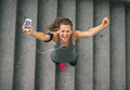 Fitness Woman With Cell Phone Outdoors In The City Royalty Free Stock Photo - 44633785