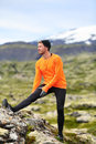 Runner Man Stretching Legs After Running Trail Run Royalty Free Stock Photo - 44653965
