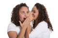 Typical Girlfriends Talking About Secrets: Two Girls Isolated. Royalty Free Stock Images - 44660679