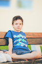 Sad Boy Sitting On A Bench Stock Images - 44672044