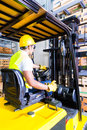 Asian Fork Lift Truck Driver Lifting Pallet In Storage Stock Image - 44693521