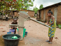 African Rural Girl Child Fetching Water Stock Images - 44695264