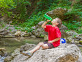 Happy Smiling Child Boy Drinking Water On Forest River Back Stock Photo - 44695430