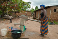 African Woman Fetching Water Royalty Free Stock Images - 44695449