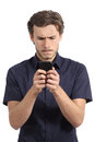 Young Man Obsessed With His Smart Phone Royalty Free Stock Photography - 44696417