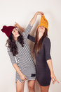 Funny Girl Friends With Wool Caps Royalty Free Stock Photography - 44700127