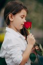 Little Girl Smell Rose Outdoor Stock Photography - 44705382