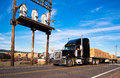 Semi Truck With Timber Near An Electrical Substation Royalty Free Stock Images - 44711979
