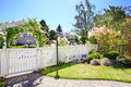 Front Yard With White Fence And Landscape Royalty Free Stock Photo - 44715615