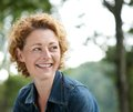 Attractive Older Woman Smiling And Looking Away Stock Image - 44753881