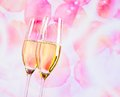 Champagne Flutes With Golden Bubbles On Blur Petals Of Roses Background Stock Photos - 44759343