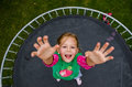 Little Girl Jumping On Trampoline Royalty Free Stock Image - 44779136
