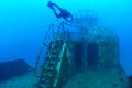 Divers Exploring The Ship Wreck In Tropical Sea Stock Image - 44786101
