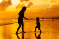 Mother And  Son Playing On The Beach Stock Images - 44788364