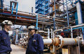 Oil And Gas Workers Inside Large Refinery Industry Stock Photography - 44790032