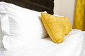 Cushions , Yellow Pillows On Bed In Hotel Room Royalty Free Stock Photo - 44797655