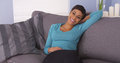 Cute Black Woman Resting On Couch Smiling Stock Images - 44819184