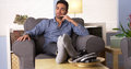 Handsome Latino Sitting At Home Thinking Stock Image - 44820031