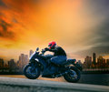 Young Man And Safety Suit Riding Big Motorcycle Against Beautifu Stock Images - 44826804