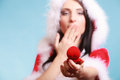 Woman Santa Claus Costume Holds Gift Boxes With Ring On Blue Stock Images - 44842504