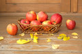 Autumn Still Life With Red Apples In A Wicker Basket And Yellow Leaves Royalty Free Stock Image - 44855756