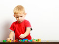 Little Boy Child Playing With Building Blocks Toys Interior. Stock Images - 44856174