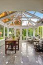 Sunroom Patio Area With Transparent Vaulted Ceiling Stock Image - 44862821
