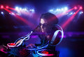 Disc Jockey Playing Music With Light Beam Effects On Stage Royalty Free Stock Photo - 44864455