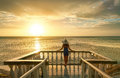 Woman On Balcony Looking At The Beautiful Sunset. Stock Images - 44877444