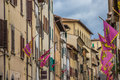 Old Houses And Flags In The Center Of Arezzo Stock Photography - 44890862