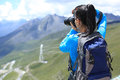Woman Photographer Taking Photo At Plateau Mountain Peak In Tibet,china Stock Images - 44895594