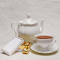 Tea Set With Box Of Gold Candies Royalty Free Stock Photography - 44921717