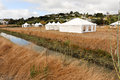 White Tents In A Dry Field Outdoors Royalty Free Stock Images - 44923349