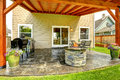 Patio Area With Tile Floor And Stone Trimmed Fire Pit Royalty Free Stock Photography - 44964377