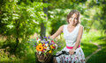 Beautiful Girl Wearing A Nice White Dress Having Fun In Park With Bicycle. Healthy Outdoor Lifestyle Concept. Vintage Scenery Stock Images - 44975734